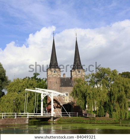 East gate with typical bridge, Delft, The Netherlands - stock photo