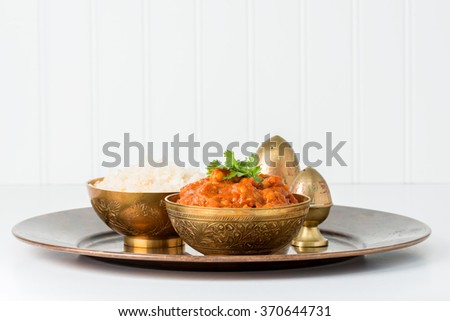East Indian chana masala served with white rice. - stock photo