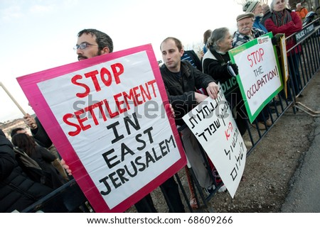 EAST JERUSALEM - JANUARY 9: Activists protest the demolition of buildings in the East Jerusalem neighborhood of Sheikh Jarrah to make way for Jewish settlements on Jan. 9, 2011 in East Jerusalem.