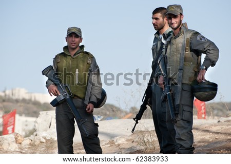 EAST JERUSALEM - OCTOBER 1: Heavily armed Israeli police guard Israeli settlements in the Arab East Jerusalem neighborhood of Sheikh Jarrah on Oct. 1, 2010.
