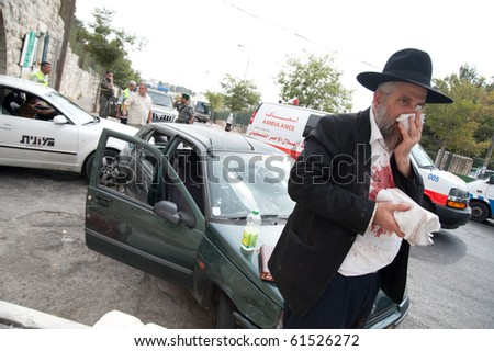 EAST JERUSALEM - SEPTEMBER 22: An Israeli tends his injuries after his car was attacked in reprisals after an Israeli security guard killed a Palestinian on September 22, 2010 in East Jerusalem - stock photo