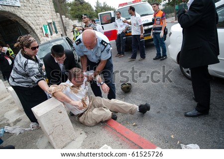 EAST JERUSALEM - SEPTEMBER 22: Police and medics attend Israelis injured when their cars were attacked in reprisals after an Israeli security guard killed a Palestinian on September 22, 2010 in East Jerusalem
