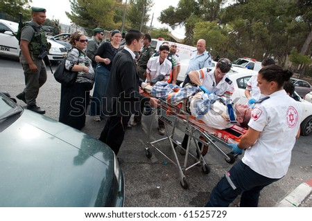 EAST JERUSALEM - SEPTEMBER 22: Police and medics attend Israelis injured when their cars were attacked in reprisals after an Israeli security guard killed a Palestinian on September 22, 2010 in East Jerusalem - stock photo
