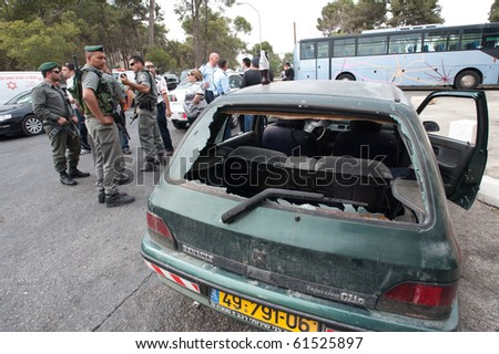 EAST JERUSALEM - SEPTEMBER 22: Police guard the scene after Israelis were attacked in their cars in reprisals after an Israeli security guard killed a Palestinian Jerusalem on September 22, 2010 in East Jerusalem - stock photo