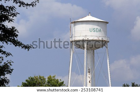 EAST LANSING, MI - AUGUST 1: A USDA water tower located in East Lansing, Michigan on August 1, 2014. The USDA executes US federal government policy on farming, agriculture, forestry, and food. - stock photo