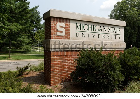 EAST LANSING, MI - AUGUST 1: An entrance to Michigan State University located in East Lansing, Michigan on August 1, 2014. MSU is a public research university founded in 1855. - stock photo