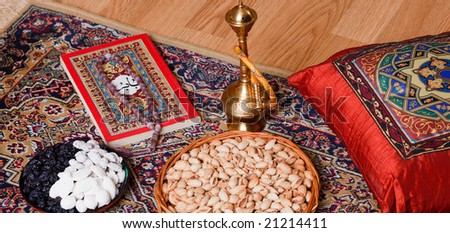 East lifestyle. The rest on the rug with almonds, sweets, hookah and book