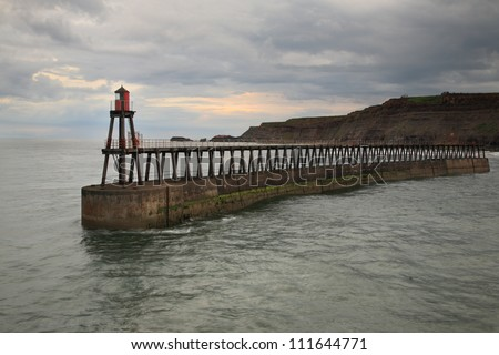 East Pier, Whitby, North Yorkshire at dusk