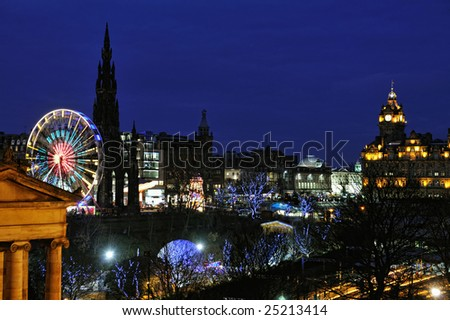 East Princes Street Gardens, Edinburgh, Scotland, with Christmas and Hogmanay holiday attractions, at night.  The Royal Scottish Musem, Big Wheel, Scott Monument and Balmoral make a colourful scene. - stock photo