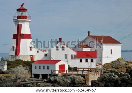 East Quoddy Lighthouse on Campobello Island, New Brunswick, Canada, is jointly owned by the U.S. and Canada - stock photo