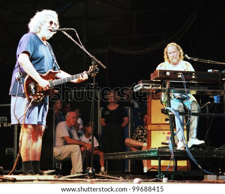 EAST RUTHERFORD, NEW JERSEY - AUGUST 3: The Grateful Dead in concert in East Rutherford, New Jersey, on Sunday, August 3, 1994. Seen here is Jerry Garcia, at left, and Vince Welnick on keyboards. - stock photo
