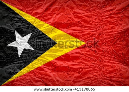 East Timor flag pattern overlay on floyd of candy shell, vintage border style - stock photo