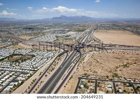 East Valley interchange of the U.S. 60 Superstition freeway and the Loop 202 Red Mountain freeway in Mesa, Arizona looking east with the Superstition Mountains in the distance - stock photo