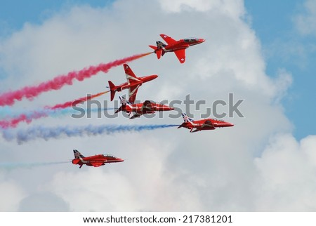 EASTBOURNE, ENGLAND - AUGUST 14, 2014: RAF aerobatic display team The Red Arrows perform at the annual Airbourne airshow. The team were first formed in 1965. - stock photo