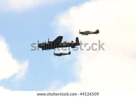EASTBOURNE, ENGLAND-AUGUST 16: The Battle of Britain Memorial Flight consisting of a Lancaster bomber flanked by a Hurricane and Spitfire, giving a display on August 16, 2009 in Eastbourne, Sussex.
