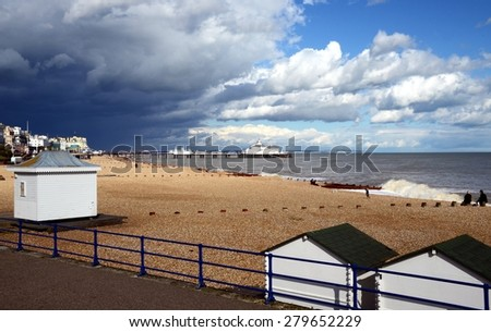 Eastbourne Pier and beach, East Sussex, England, UK. Eastbourne is a large town, seaside resort. - stock photo