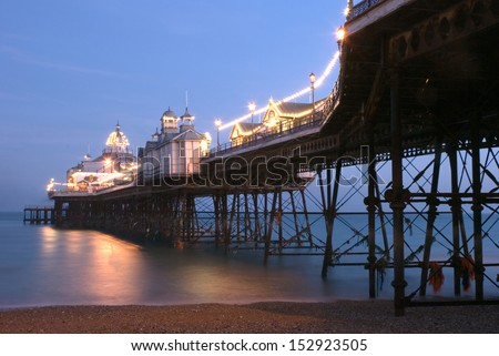Eastbourne pier at dusk, United Kingdom - stock photo