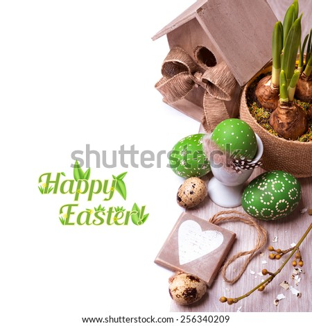 "Easter arrangement with daffodil sprouts, painted eggs and caption ""Happy Easter"" - stock photo"