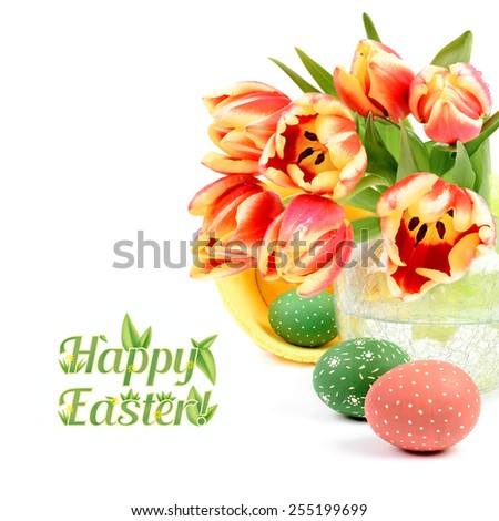 "Easter arrangement with tulips, painted eggs and caption ""Happy Easter"" - stock photo"