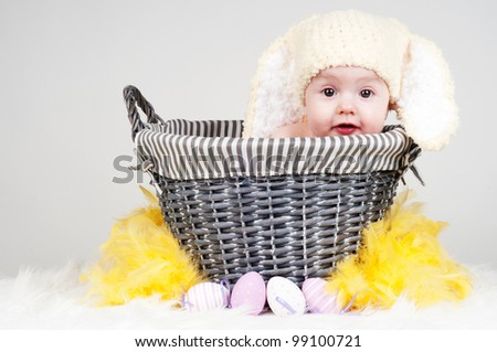 Easter baby girl in basket