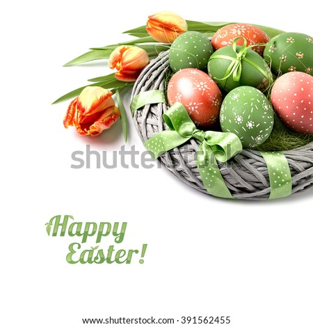 "Easter backet with eggs and tulips, caption ""Happy Easter"" - stock photo"