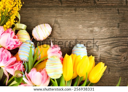 Easter Background. Beautiful Easter holiday backdrop frame decorated with colourful eggs and tulip flowers. Springtime - stock photo