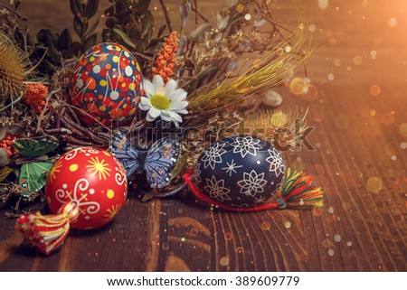Easter background. colored Easter eggs and composition of dried flowers and plants. on wooden background. soft light effect. Easter theme. Happy Easter - stock photo