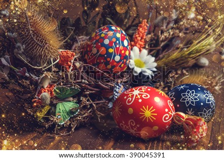 Easter background. colored Easter eggs and composition of dried flowers and plants. on wooden background. Easter theme. Happy Easter.  shallow depth of field. instagram toning effect - stock photo