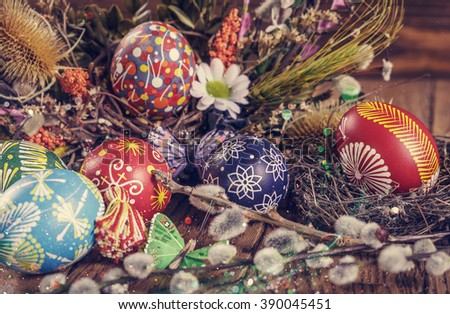 Easter background. colored Easter eggs in the nest and composition of dried flowers and plants. on wooden background. easter theme. happy easter. instagram toning effect. Easter holiday - stock photo
