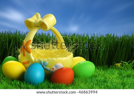 Easter background, multi-coloured eggs, grass and blue sky