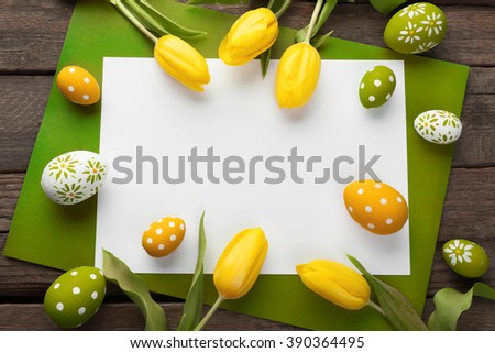 Easter background with colorful eggs over white wood - stock photo