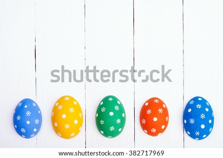 Easter background with copy space. Easter eggs on a wooden background. Top view - stock photo
