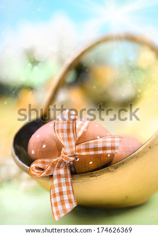 Easter background with decorated egg in focus, shallow DOF   - stock photo