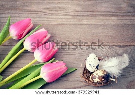 Easter background with easter eggs and tulips. Copy space, for easter text. Easter card, easter flower. Easter eggs for easter nest.  - stock photo