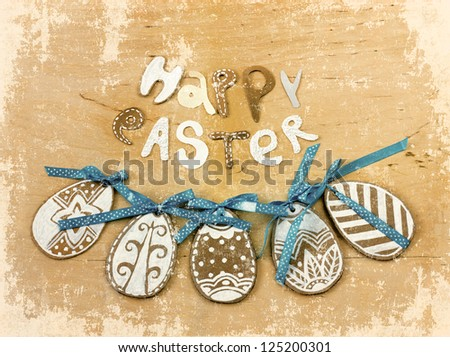 "Easter  background with eggs and lettering ""happy easter""/Vintage Easter card with eggs on wooden background - stock photo"