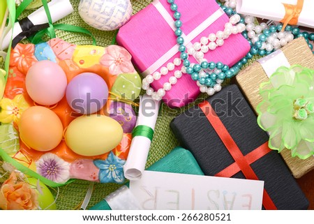 Easter background with eggs, ribbons and spring decoration - stock photo
