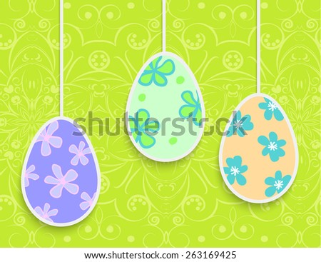 Easter background with hanging on the ropes patterned eggs
