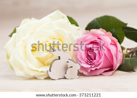 easter background with roses and bunnys