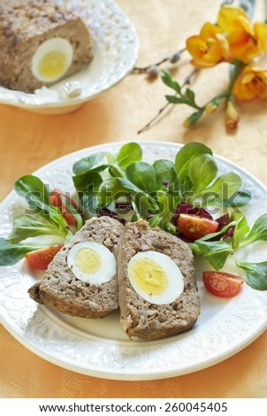 Easter baked meatloaf with boiled eggs - stock photo