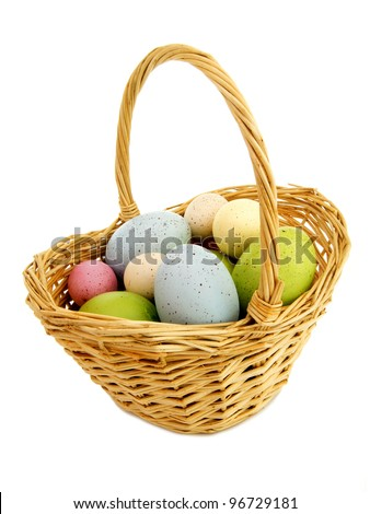 Easter basket filled with colorful eggs isolated on white - stock photo