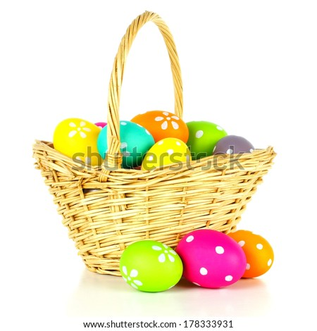 Easter basket filled with colorful eggs over a white background              - stock photo