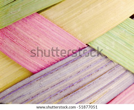 easter basket weaving patter in pink yellow purple and green - stock photo