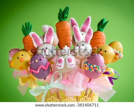 Easter basket with cake pops on green background,selective focus  - stock photo
