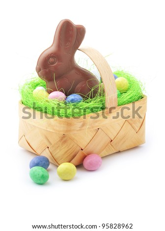 Easter basket with candy and chocolate rabbit - stock photo