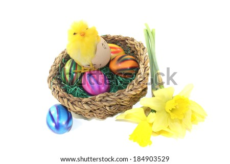 Easter Basket with chick on a light background