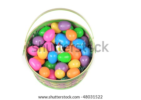 Easter basket with colored eggs,grass and hen