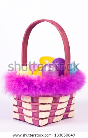 Easter basket with colorful eggs