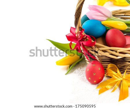 Easter basket with Easter Eggs and tulips  - stock photo