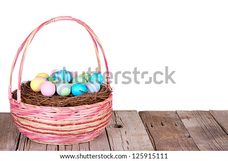 Easter Basket with Easter eggs on a wooden plank with a isolated white background