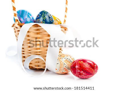 Easter basket with eggs and ribbon on white - stock photo